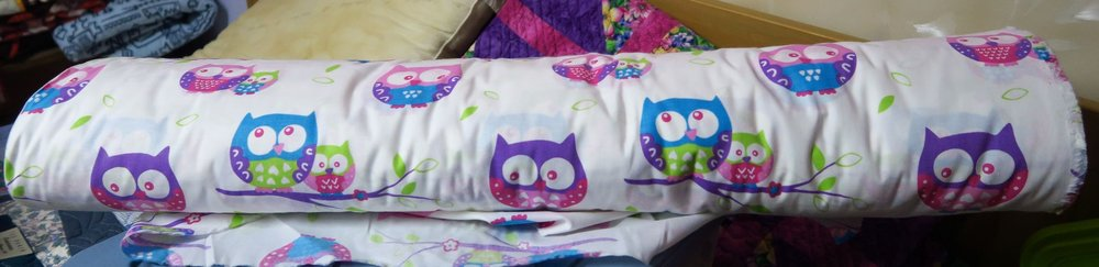 My bolt of owl fabric. I bought it on our auction site a few years ago and made up owl quilts til I was sick of them. So I put it away but am ready to tackle some more! The bolt had about 70 meters on it! It's from a Polish manufacturer.