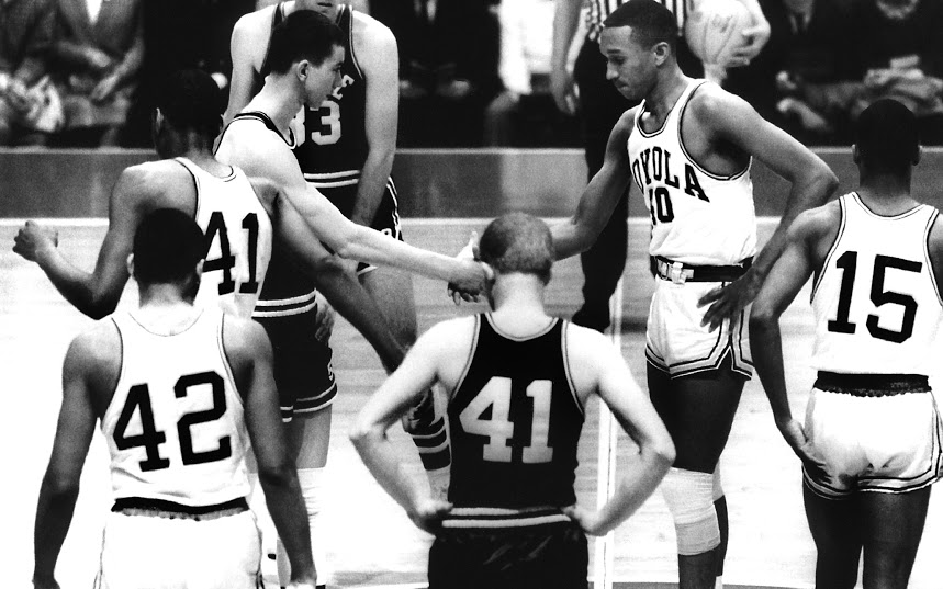 Loyola University vs. Mississippi State tip off in the 1963 NCAA tournament.