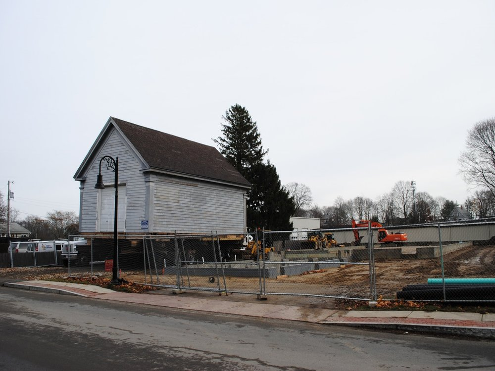 Construction begins as the schoolhouse is moved into place. (December 8, 2016)