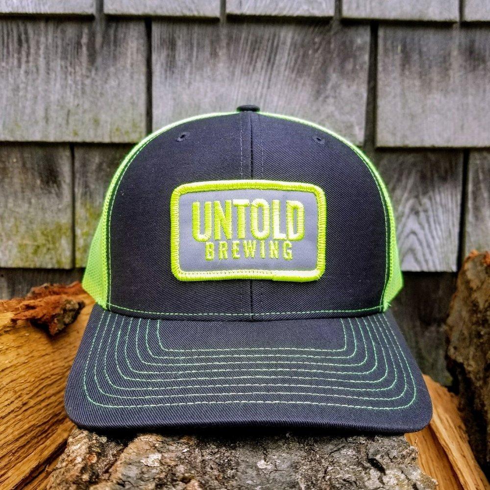 neon yellow trucker hat untold brewing