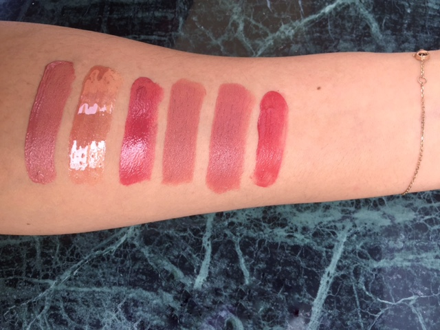 Left to right: Estee Lauder Pure Color Envy Lip Potion in Vague Obsession,  enty Beauty Gloss Bomb Universal Lip Luminizer, Chanel Rouge Coco Stylo in Message, Hourglass Confession Lipstick in I Want, M.A.C Liptensity Lipstick in Smoked Almond, Becca Beach Tint in Watermelon.
