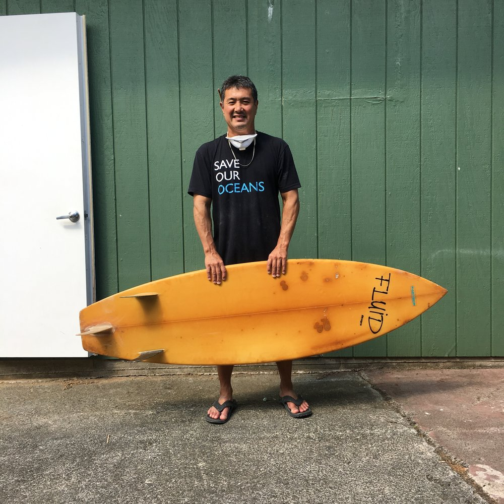 Wade holding the first board he shaped. Photo: Wade Tokoro