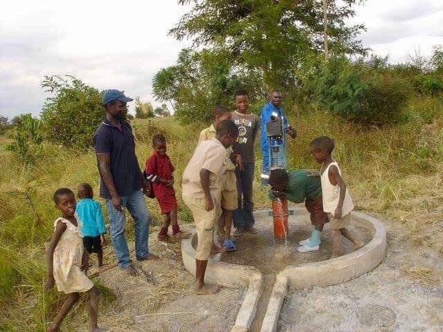 locals standing around a well
