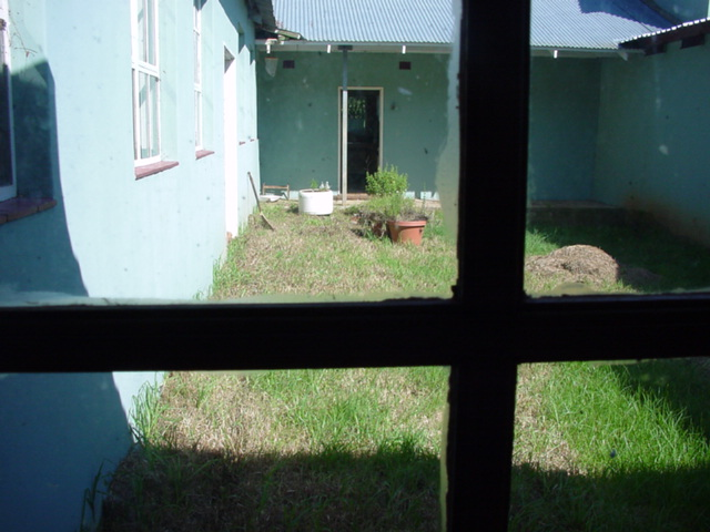 062._jan_2002_courtyard_thru_window_1.jpg