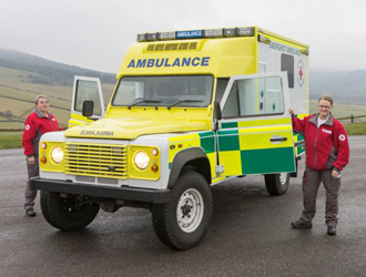 Defender-ambulance-with-Red-Cross-volunteers-Judith-Ward-and-Joanne-Glover..jpg