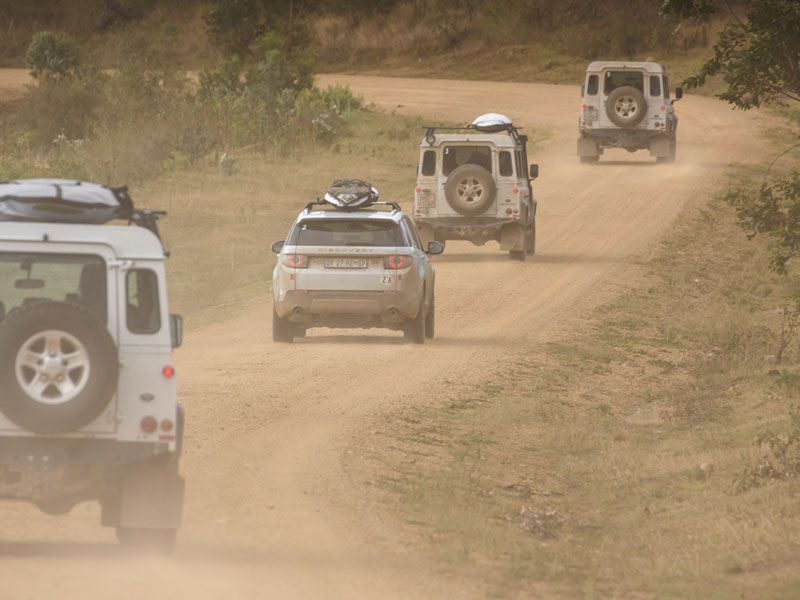 A_convoy_of_Land_Rover_vehicles_negotiating_their_way_through_testing_terrain_on_the_1000km_journey.jpg