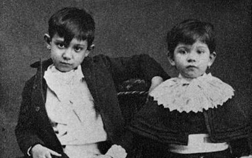Pablo Picasso with his sister Lola, 1889
