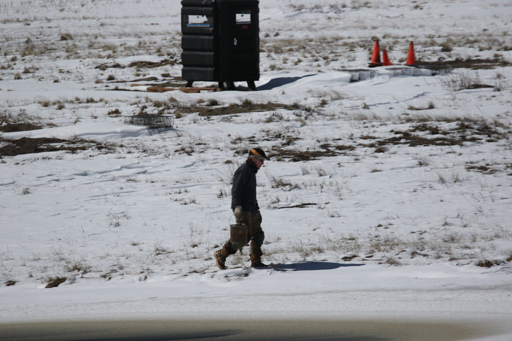 Armed with flagging tape, a permanent marker, and a bait bucket, John walks to a surrounding to check the traps.  ©MRR 2017
