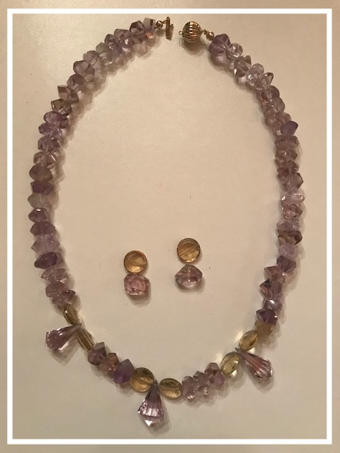 Amethyst Necklace:  Amethyst beads with amethyst briolett and beer quartz accent beads. Clasp is 14K gold. Length is 20 inches. Includes beads for earrings. Valued at $300.00.  Handmade by Susan Scrimshaw.