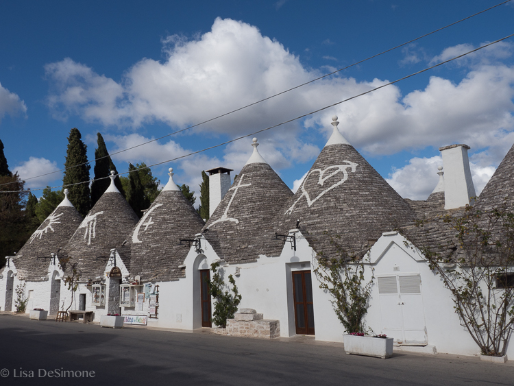 Souvenir shops line the commercial district of Alberobello