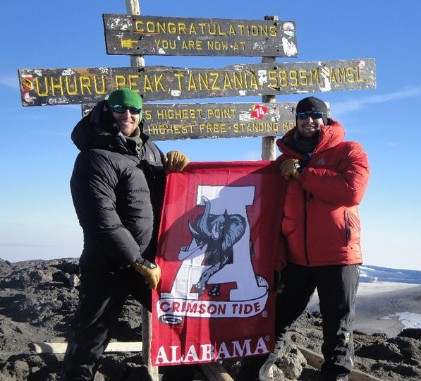 Austin (left) with his brother on the summit of Kilimanjaro, in Tanzania, Africa