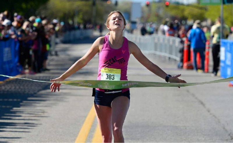 Many people liken giving birth to running a marathon.  Nicole Lyons  crossing the finish line.