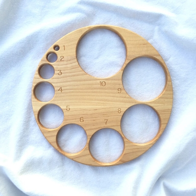 I love this beautiful wooden dilation board by  From Jennifer on Etsy!