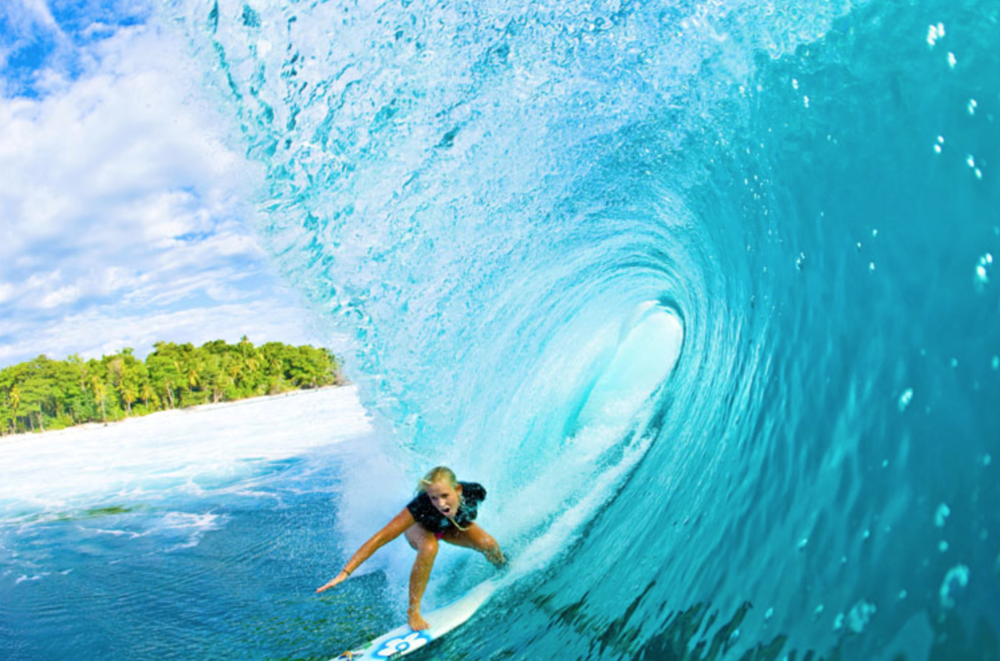 Surfing is so cool. And hard. I tried one time and could hardly stand up on the board.