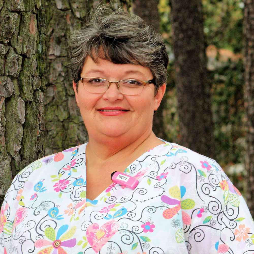 VICKI  Vicki was raised in Campobello, SC and graduated from Landrum High School and Spartanburg Community College as a certified Dental Assistant. She has been with our team since 1994 as Dr. B.H. Satterfield's assistant.  She is certified in radiation saftey, nitrous oxide monitoring and CPR. She is our Medical Emergency coordinator and orders our office supplies. She married her high school sweetheart in 1989, and they have two sons. When she is not at work, Vicki enjoys spending time with her family and making memories.