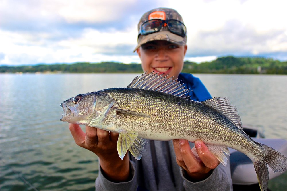 At 14, Micah isn't just an awesome fisherman, but he's a valued helper and first mate. He will help make your time on the water a pleasure!