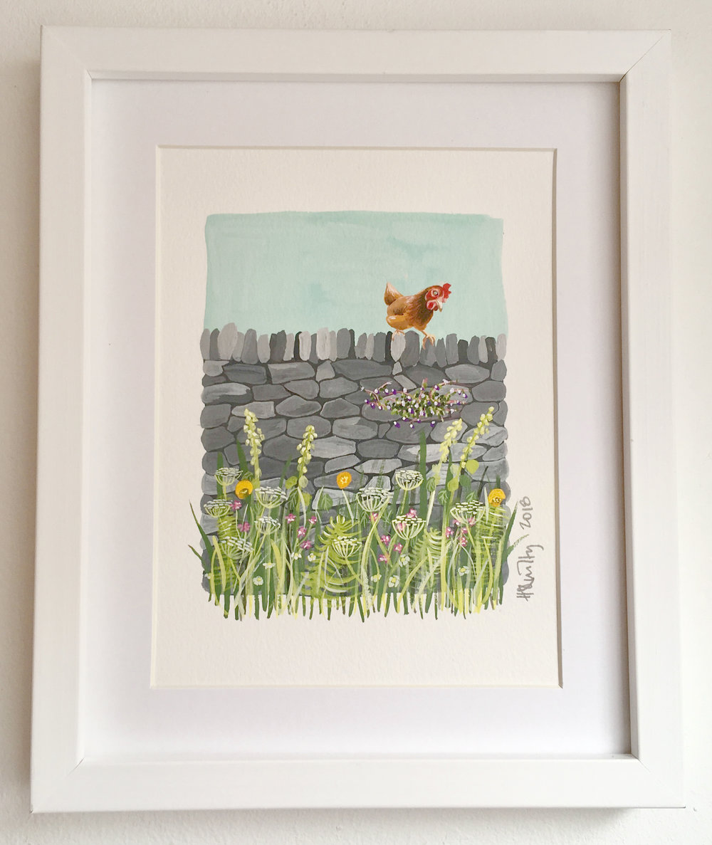 Chicken on a dry stone wall