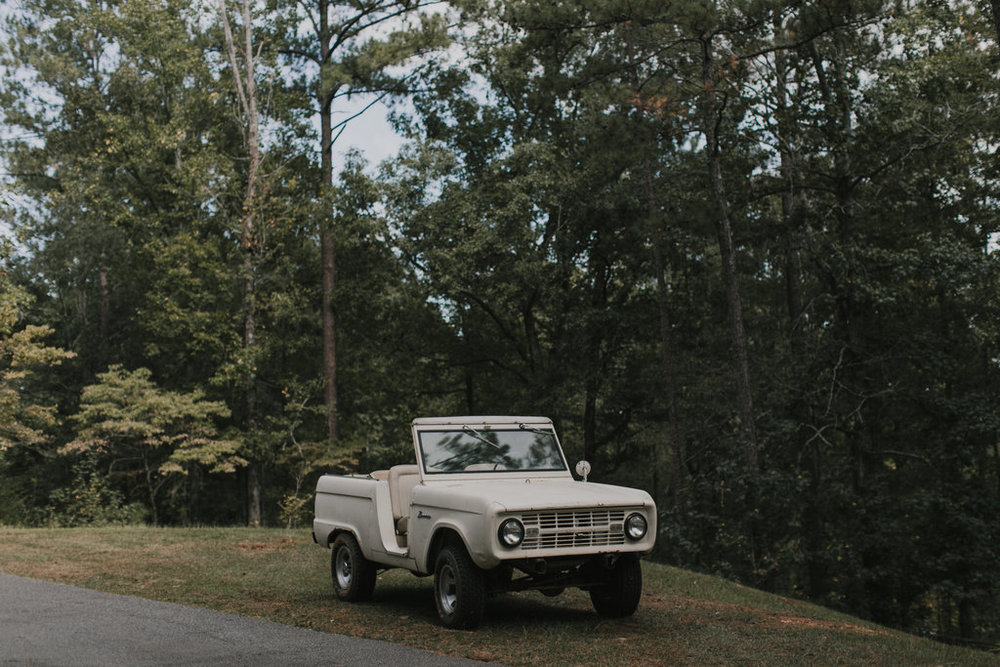 vintage car too?! this old bronco came to life again to cart the bride to the ceremony - and host bride and groom pics (rightfully so for the groom who's a mechanic)