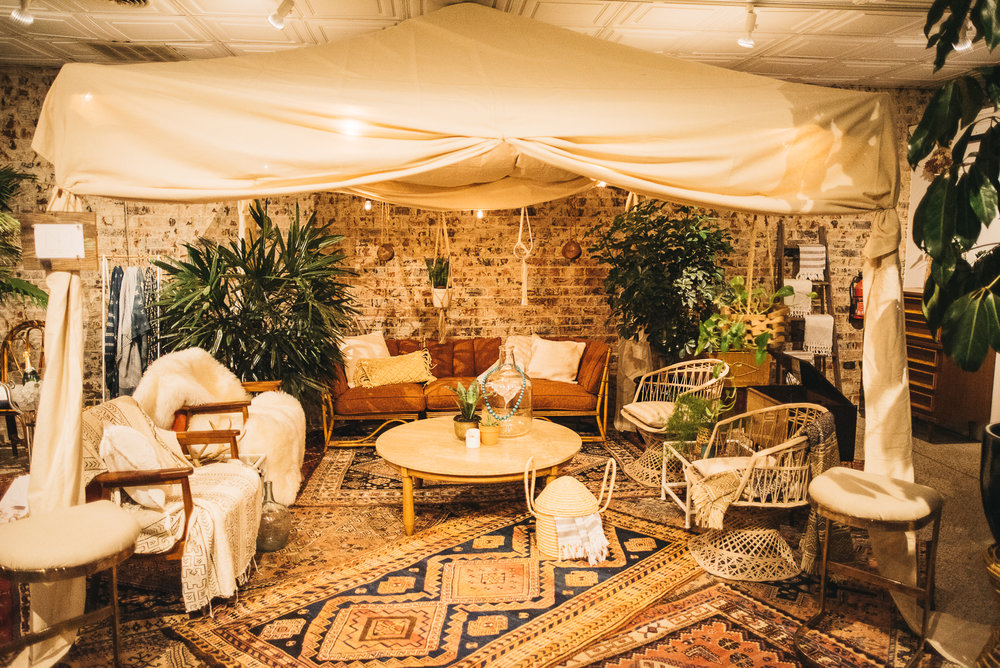 a wide shot of the jungalow itself! Don't you love all the layered rugs? They made the space feel so cozy! Even if you just have ONE of the gorgeous Persians but you want a layered look - you can always put a larger jute, or other neutral rug underneath!