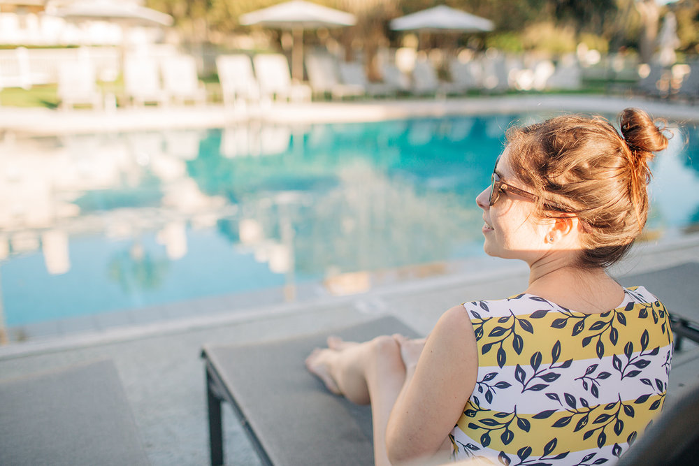 Young woman lounging at the Jekyll Island Club Pool