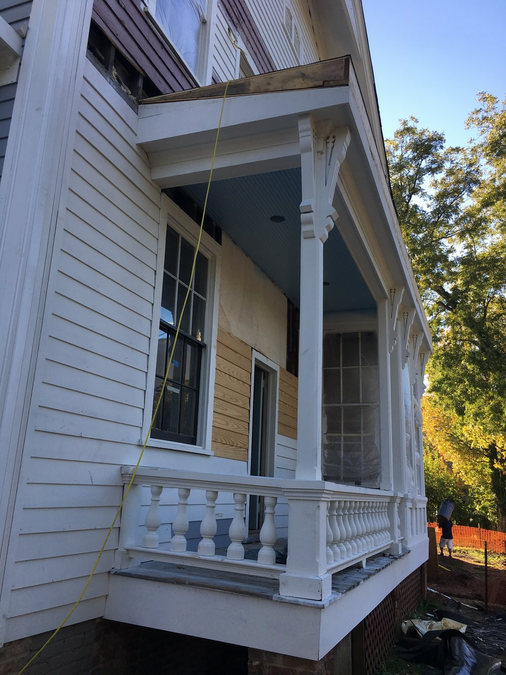 Our haint blue ceilings are in place on the north porch and the front porch!