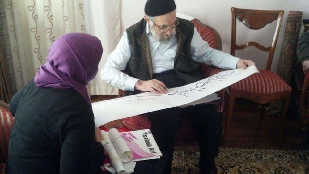 Hasan hoca examining Gulnaz's work