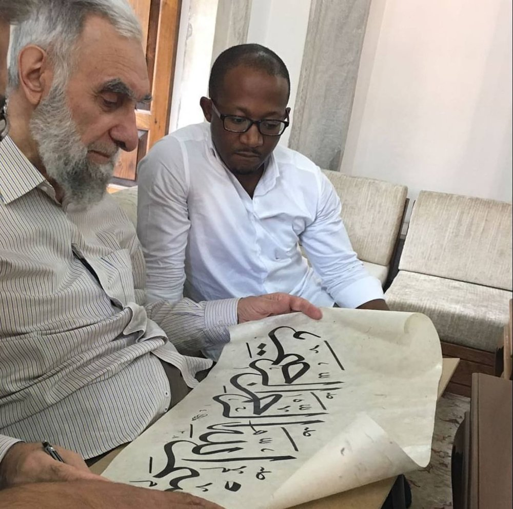 Muhammad Hobe with his teacher, master calligrapher Hasan Çelebi hoca