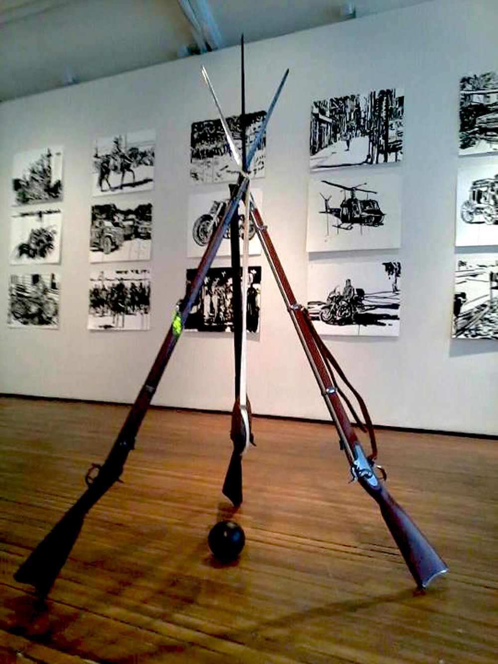 "Stacked Muskets at Christopher Henry Gallery Show, ""Exploding Sky"". July 2014. Ink Drawings in background."