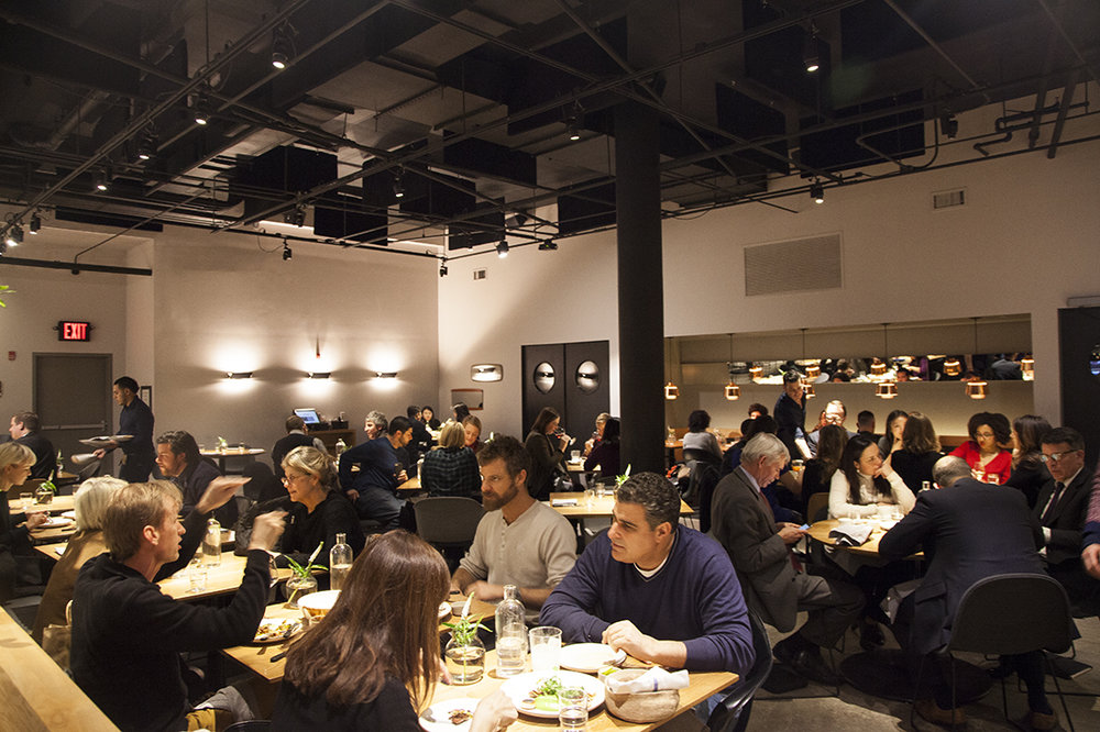 Diners enjoy a busy lunch service in Cosme's spacious dining room.