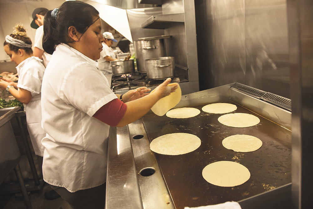 Guadalupe, at the tortilla station, makes thousands of tortillas a day for the diners at Cosme.