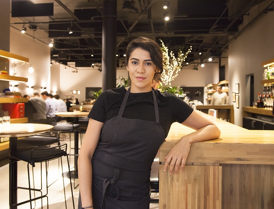 Chef Daniela Soto-Innes stands by the bar at Cosme, located in the Flatiron District of New York City.