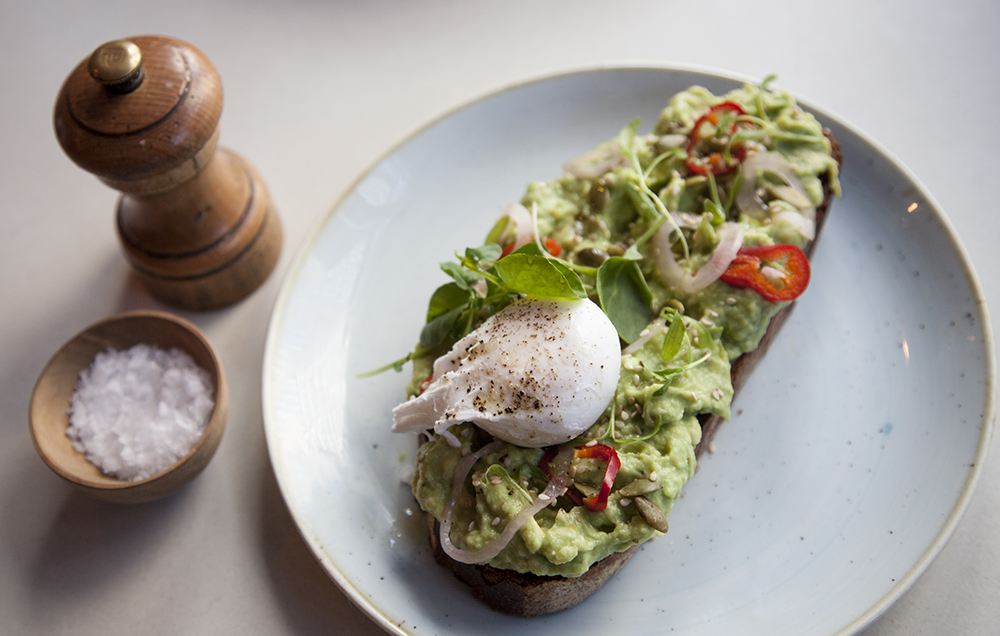 Two Hands' take on smashed avocado toast comes with pickled shallots, cilantro, pepitas, sesame, chili and lime on sourdough bread.