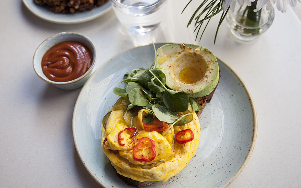 "Giles' go-to breakfast (read his ""Dining Quirk"" below) is the pickled chili scrambled eggs, which comes on sourdough topped with watercress and avocado."