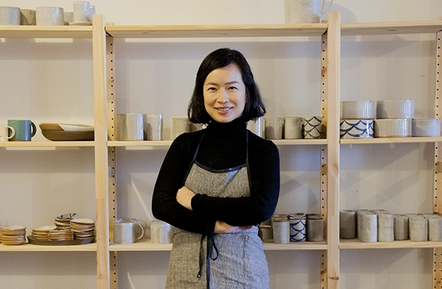 "Re Jin (""RJ"") Lee stands in BDB's ceramics studio in Greenpoint, Brooklyn."