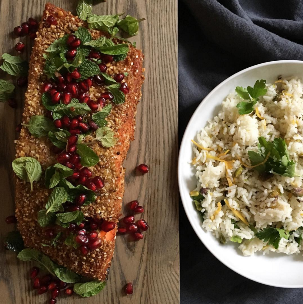 Dukkah-crusted salmon topped with mint leaves and pomegranate; jeweled basmati rice with pistachio and candied orange. [Photo by Poppy's]