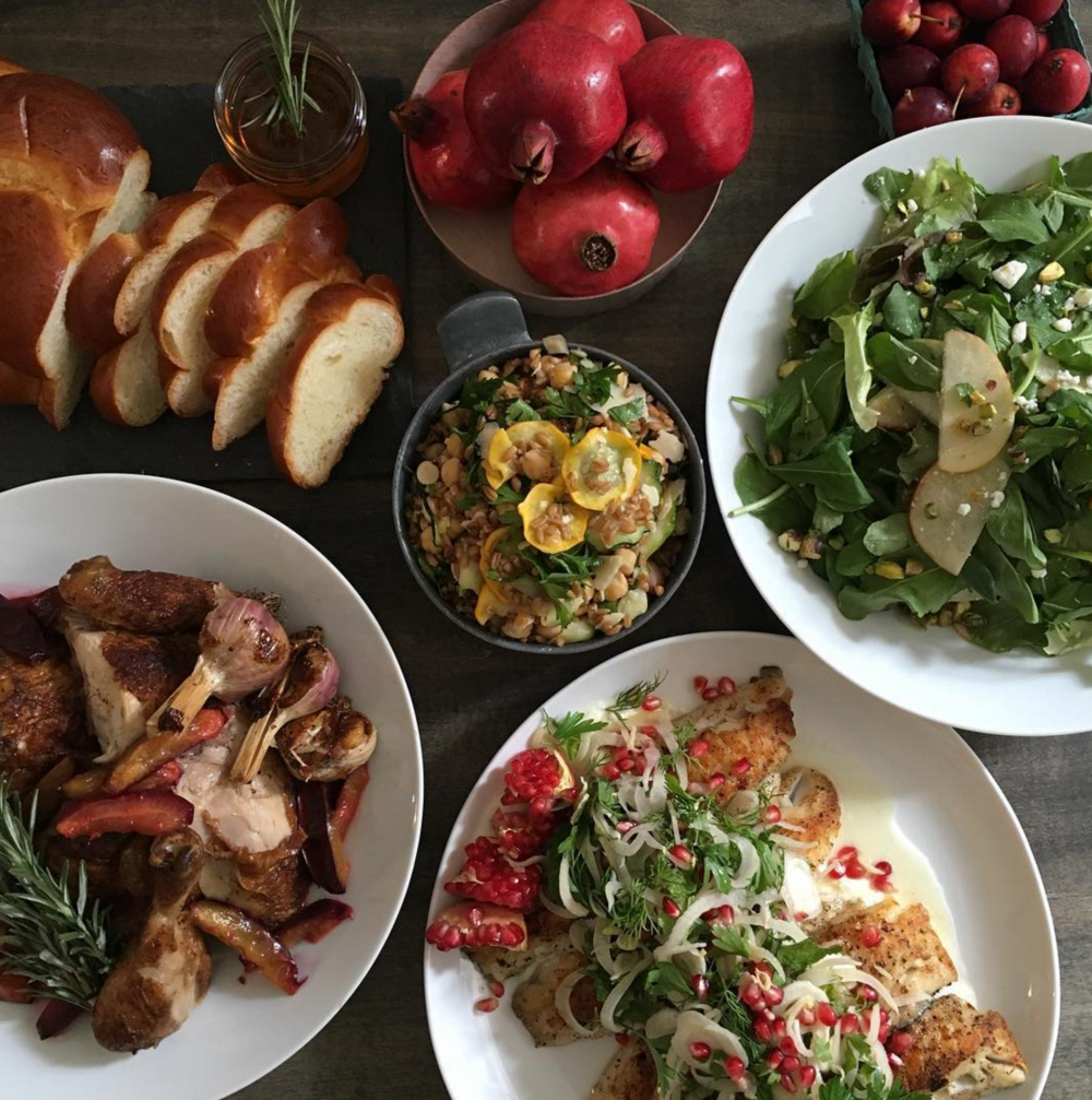 A holiday menu features pasture-raised rotisserie chicken with caramelized plums + roasted garlic, a farro salad of roasted plums, manouri, hazelnuts and herbs, and black bass topped with a pomegranate herb salad + lemon yogurt sauce. [Photo by Poppy's]