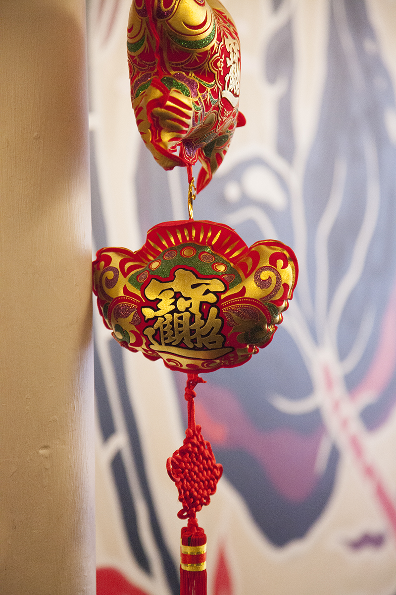 The many red and gold ornaments at Fung Tu represent good luck and fortune.