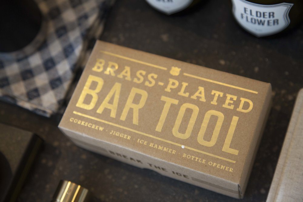 The 4-in-1 bar tool from Izola breaks ice, measures liquid, and opens both wine and beer bottles.