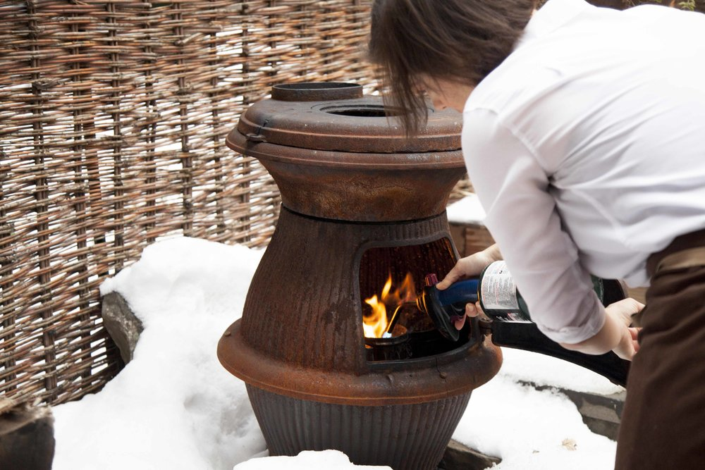 In the winter, an outdoor furnace is lit for ambience and a warm, smoky aroma.