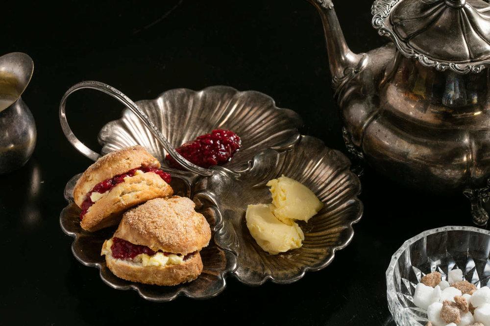 Pork lard scones are served with beurre de burrat and raspberry conserva. [Melissa Hom]