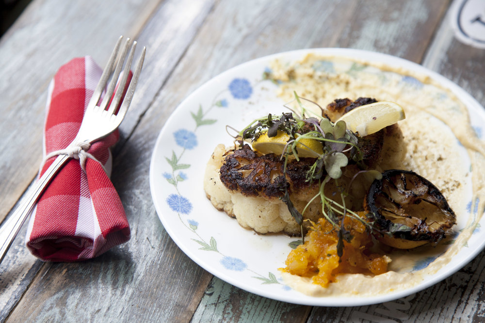 Za'atar spiced heirloom cauliflower steak with apricot-coriander labneh.