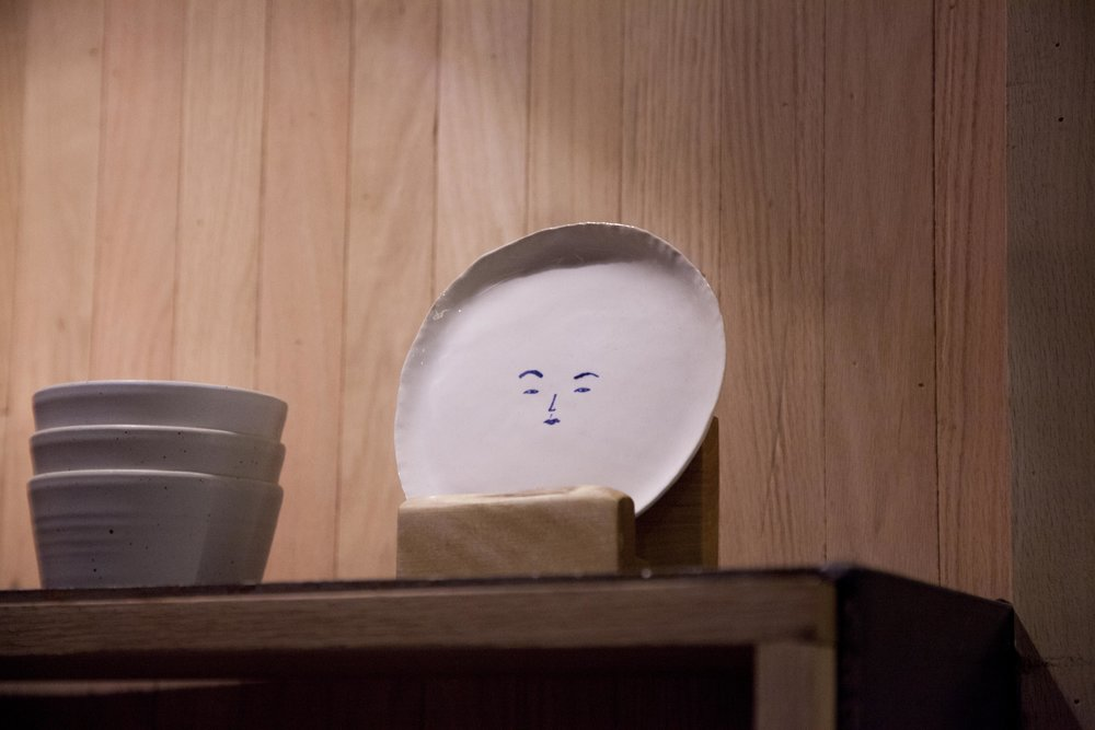 The ceramics with face art were handmade in Seoul by Chef Junghyun's cousin,  Youme Oh , as a gift for the opening of Atoboy.