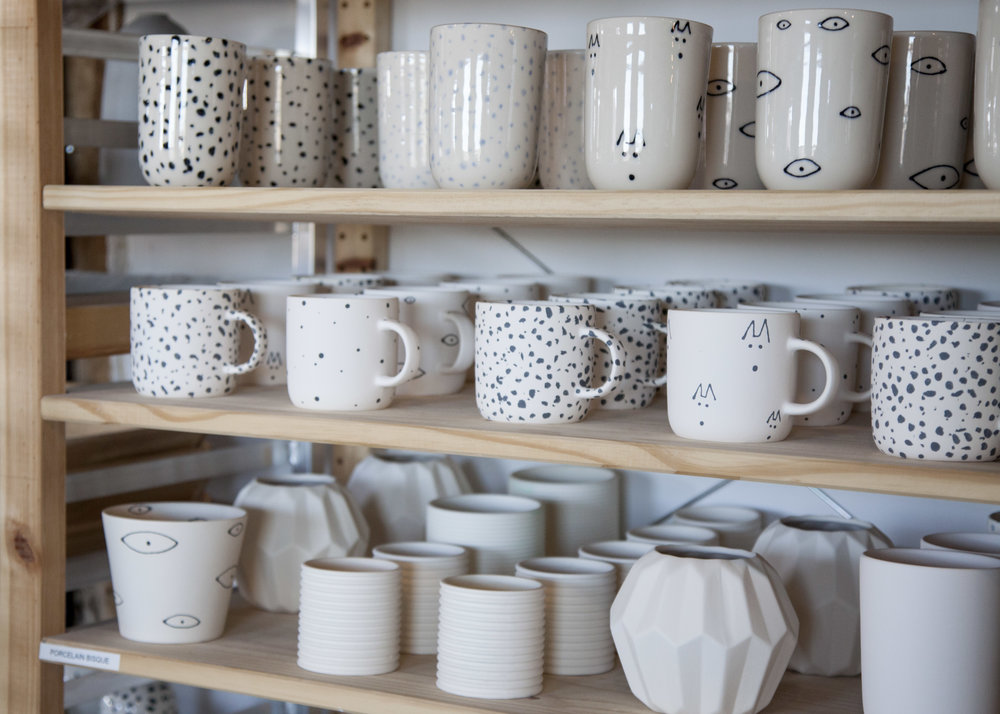 A mix of Franca patterns and ceramic pieces on their studio shelves.