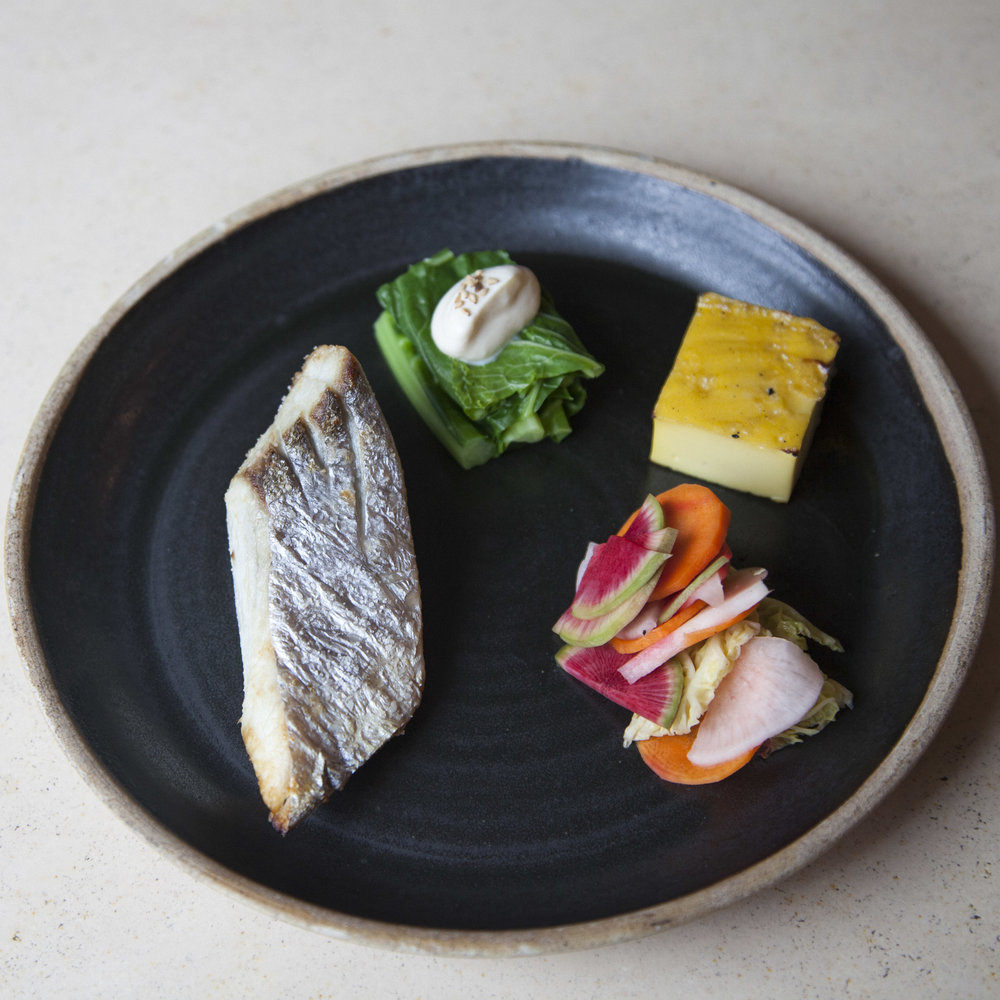 "Pictured clockwise: salt-roasted Spanish mackerel (""sawara no shioyaki""), blanched collard greens with tofu dressing (""shira-ae""), egg omelette (""baked tamagoyaki""), and lightly pickled market vegetables (asazuke tsukemono"")."
