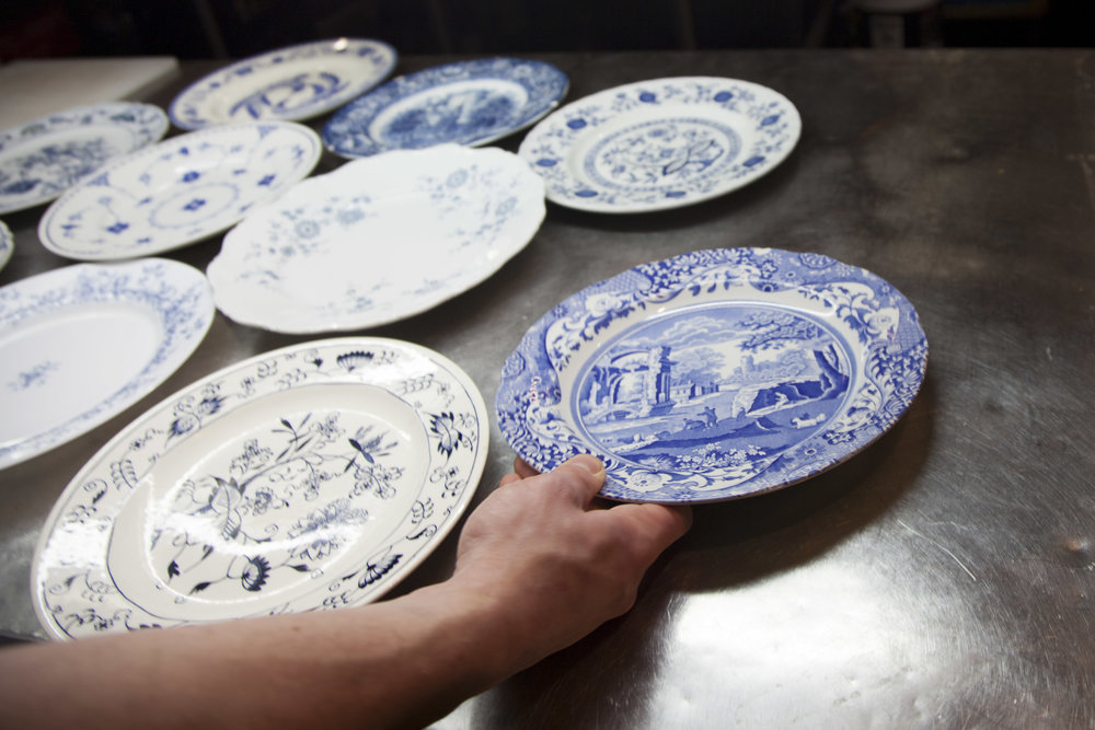 Brian lays out Acme's handpicked collection of Spode plates.