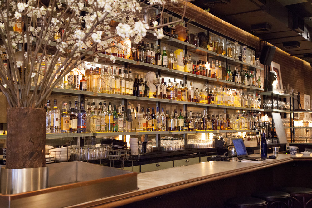 The interior of Acme reflects its persona as a warm, modern bistro with a NYC sensibility.