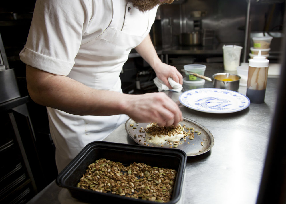 Brian adds housemade granola and an apple cider vinegar reduction to his butternut squash dish.