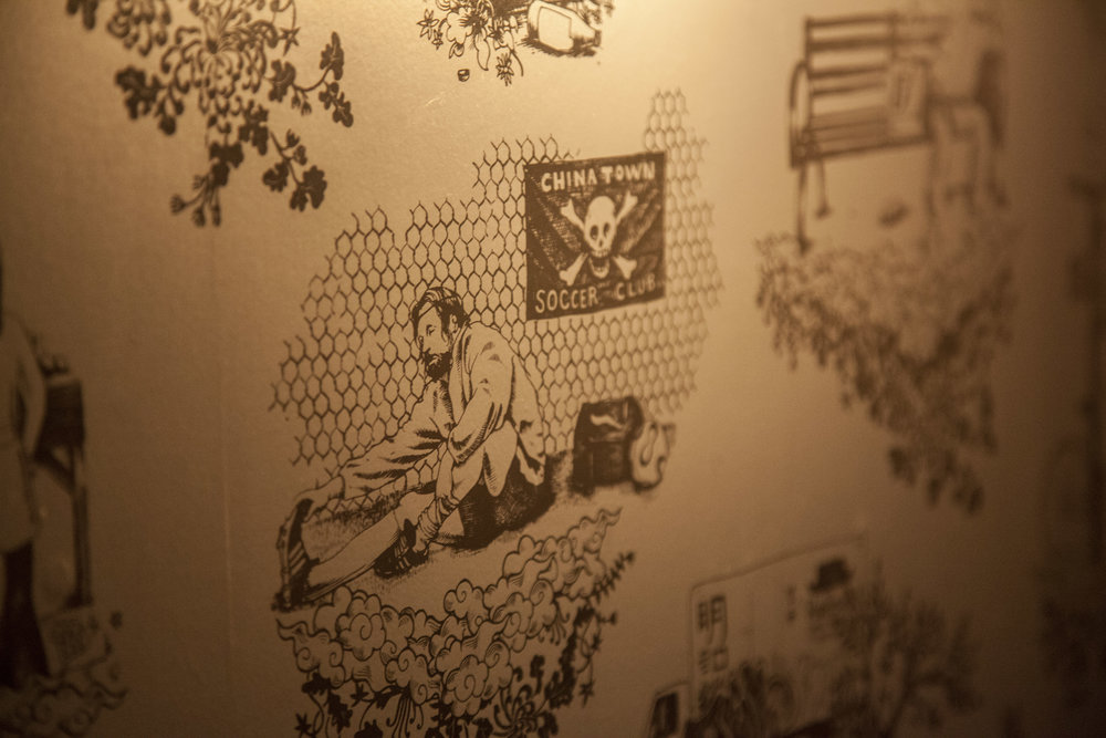 Custom-designed wallpaper in their private dining room reflects everyday scenes in Chinatown.