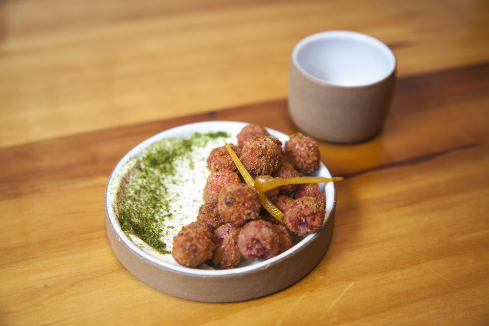 One of Maiko's favorite bites:  fried  umeboshi  (young pickled plums), served with a tahini puree.