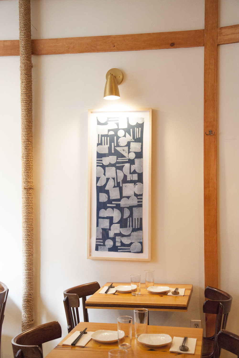 Framed indigo-dyed bandanas are from  Buaisou , a textile company founded by two Japanese indigo farmers and dyers.